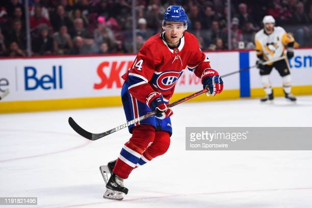 Montreal Canadiens center Nick Suzuki tracks the play on his right during the Pittsburgh Penguins versus the Montreal Canadiens game on January 04 at...