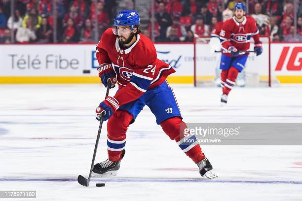 Montreal Canadiens center Phillip Danault crosses the blue line with the puck during the St. Louis Blues versus the Montreal Canadiens game on...