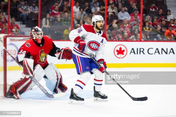 Montreal Canadiens center Phillip Danault sets up in front of Ottawa Senators goaltender Joey Daccord during third period National Hockey League...