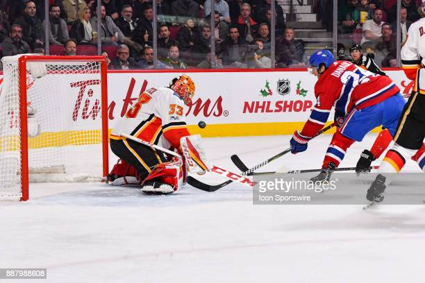 Montreal Canadiens Center Phillip Danault shoots the puck for a goal on Calgary Flames Goalie David Rittich during the Calgary Flames versus the...