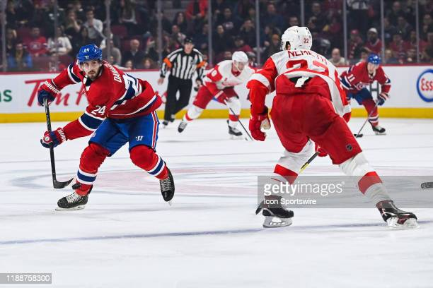 Montreal Canadiens center Phillip Danault shoots the puck into Red Wings territory during the Detroit Red Wings versus the Montreal Canadiens game on...