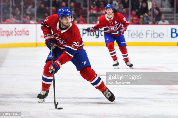 Montreal Canadiens center Phillip Danault skates across the blue line with the puck during the New York Islanders versus the Montreal Canadiens game...