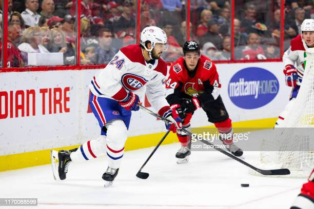 Montreal Canadiens center Phillip Danault tries to get his stick on a loose puck during second period National Hockey League preseason action between...