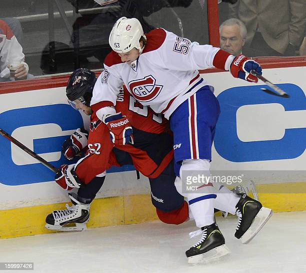 Montreal Canadiens center Ryan White checks Washington Capitals defenseman Mike Green in the third period at the Verizon Center in Washington DC...
