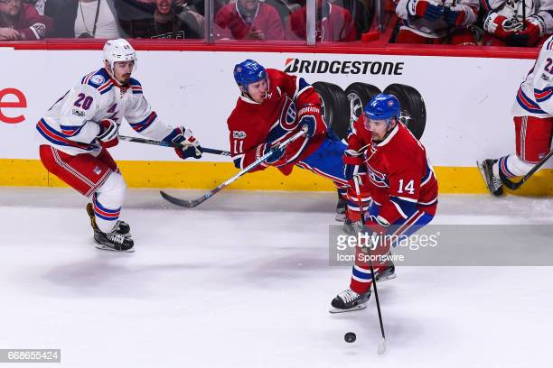 Montreal Canadiens center Tomas Plekanec controlling the puck while Montreal Canadiens right wing Brendan Gallagher falls on the ice during game 2 of...