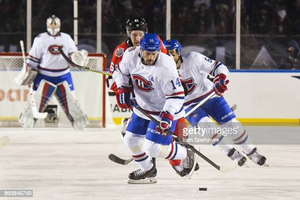 Montreal Canadiens Center Tomas Plekanec looks at the puck on the ice during the Montreal Canadiens versus the Ottawa Senators NHL100 Classic game on...