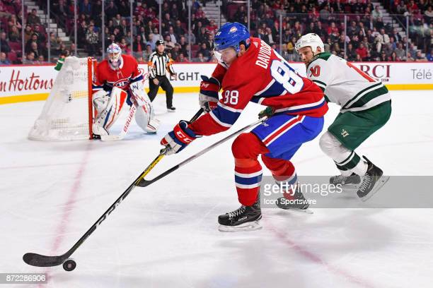 Montreal Canadiens Defenceman Brandon Davidson gains control of the puck over Minnesota Wild Right Wing Chris Stewart during the Minnesota Wild...