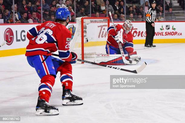Montreal Canadiens Defenceman Jeff Petry looks at the save by Montreal Canadiens Goalie Carey Price during the Calgary Flames versus the Montreal...