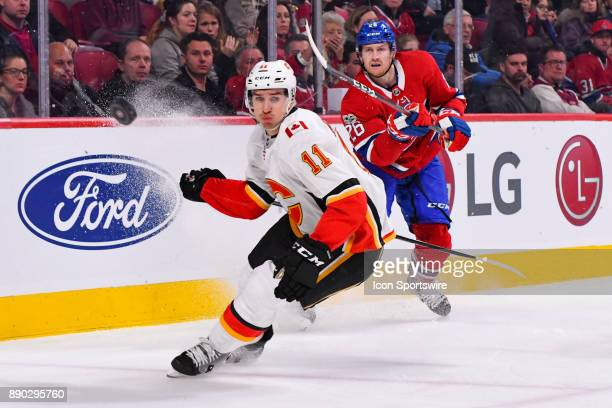 Montreal Canadiens Defenceman Jeff Petry shoots the puck away from Calgary Flames Center Mikael Backlund during the Calgary Flames versus the...