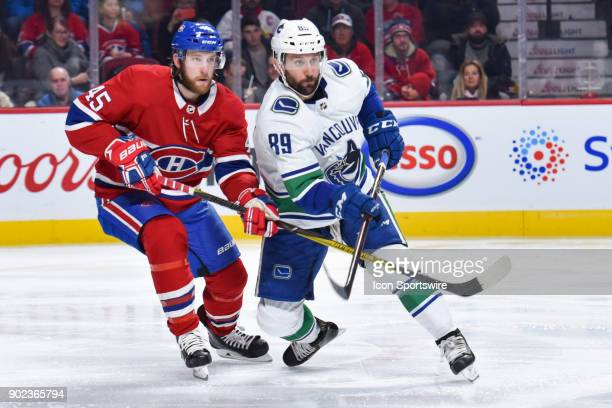Montreal Canadiens Defenceman Joe Morrow tries to push Vancouver Canucks Center Sam Gagner away from his position on the ice during the Vancouver...