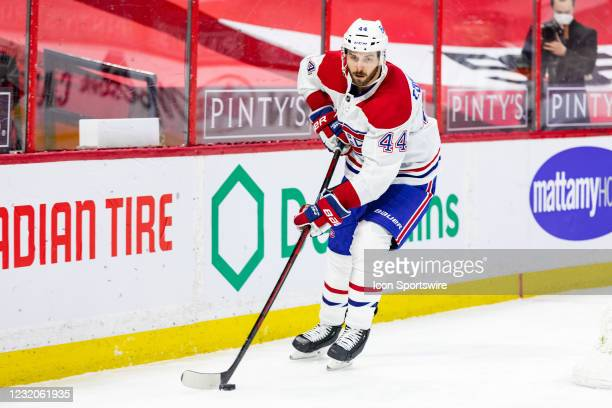 Montreal Canadiens Defenceman Joel Edmundson skates the puck around the net during second period National Hockey League action between the Montreal...