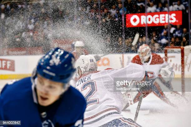Montreal Canadiens Defenceman Karl Alzner stops suddenly in a massive spray of snow as he changes direction on Toronto Maple Leafs Right Wing Kasperi...