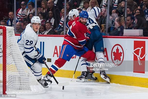 Montreal Canadiens Defenceman Shea Weber and Toronto Maple Leafs Defenceman Morgan Rielly fighting for the puck while Toronto Maple Leafs Winger...