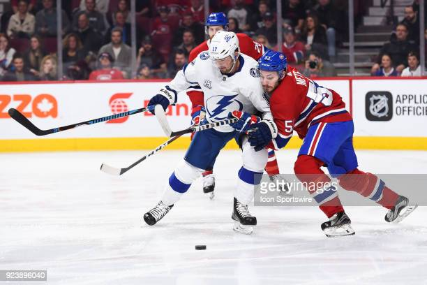 Montreal Canadiens Defenceman Victor Mete and Tampa Bay Lightning Left Wing Alex Killorn battle for the puck during the Tampa Bay Lightning versus...
