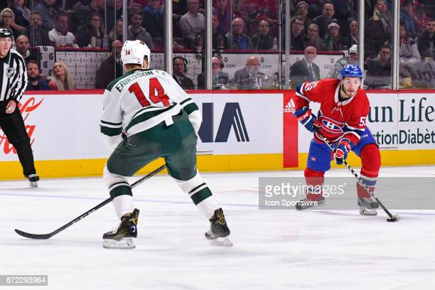 Montreal Canadiens Defenceman Victor Mete looks for a target in front or Minnesota Wild Center Joel Eriksson Ek during the Minnesota Wild versus the...