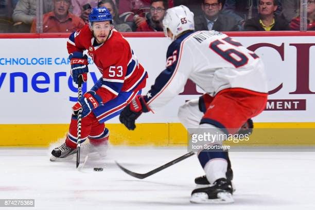 Montreal Canadiens defenceman Victor Mete looks for a tarteg to pass the puck before Columbus Blue Jackets defenceman Markus Nutivaara reaches him...