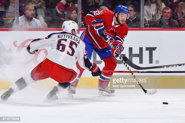 Montreal Canadiens defenceman Victor Mete passes the puck in front of Columbus Blue Jackets defenceman Markus Nutivaara during the Columbus Blue...