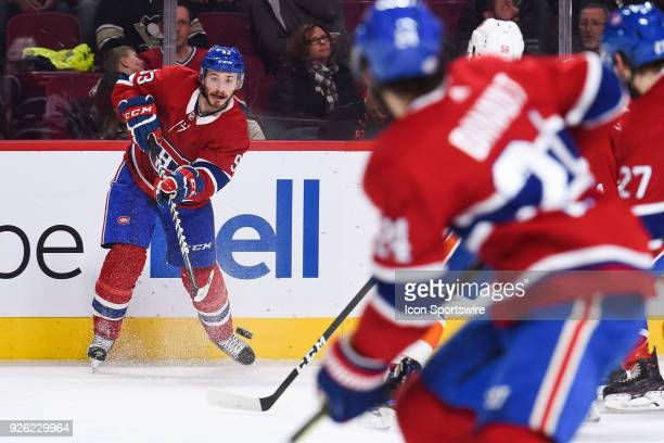 Montreal Canadiens Defenceman Victor Mete passes the puck towards Montreal Canadiens Center Phillip Danault during the New York Islanders versus the...