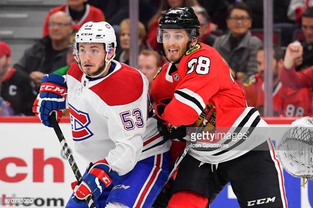 Montreal Canadiens defenseman Victor Mete and Chicago Blackhawks left wing Ryan Hartman watch for the puck during the game between the Montreal...