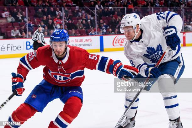 Montreal Canadiens defenseman Victor Mete and Toronto Maple Leafs right wing Connor Brown battle for the puck during the third period of the NHL game...