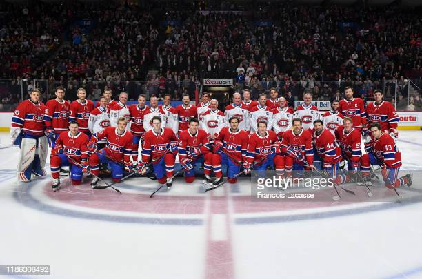 Montreal Canadiens' former captains and current players pose to a photo during ceremony in honor of Montreal Canadiens 110th anniversary prior to the...