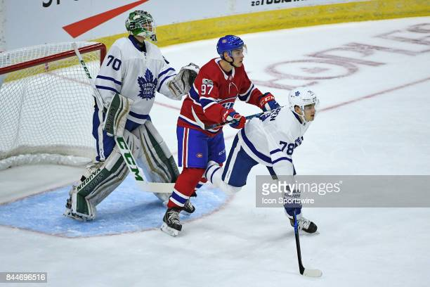 Montreal Canadiens Forward Antoine Waked and Toronto Maple Leafs Defenceman Timothy Liljegren fight for position in front of Toronto Maple Leafs...