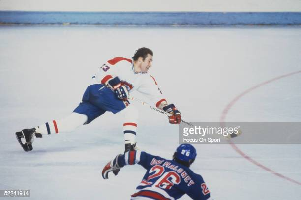 Montreal Canadiens' forward Bob Gainey takes a shot during a game at the Montreal Forum circa 1979 in Montreal Canada