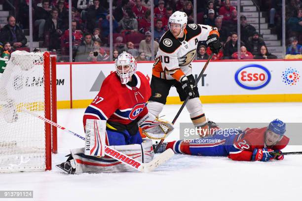Montreal Canadiens Goalie Antti Niemi Anaheim Ducks Right Wing Corey Perry and Montreal Canadiens Defenceman Karl Alzner all track the puck behind...