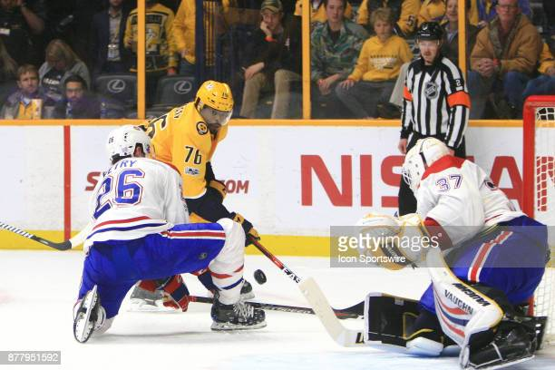 Montreal Canadiens goalie Antti Niemi protects the post as Montreal Canadiens defenseman Jeff Petry defends against Nashville Predators defenseman PK...