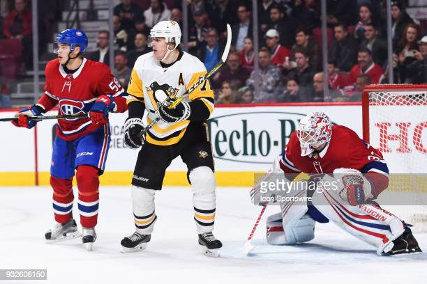 Montreal Canadiens Goalie Antti Niemi tries to look beside Pittsburgh Penguins Center Evgeni Malkin during the Pittsburgh Penguins versus the...