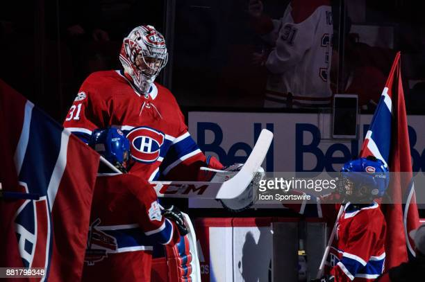 Montreal Canadiens goalie Carey Price enters the rink and taps the glove of the flag bearer the first period of the NHL game between the Columbus...