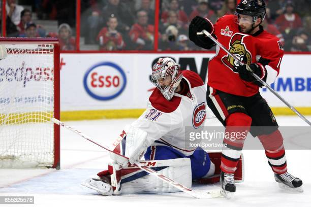 Montreal Canadiens Goalie Carey Price gets a piece of the shot with Ottawa Senators Winger Tom Pyatt trying to provide the screen in the second...