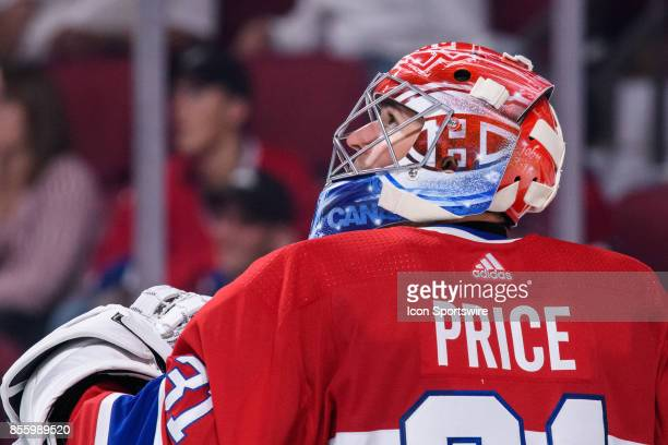 Montreal Canadiens goalie Carey Price looks at the clock during the third period of the NHL preseason game between the New Jersey Devils and the...