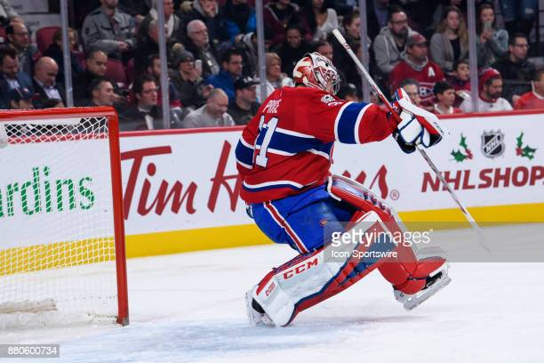 Montreal Canadiens goalie Carey Price looses his balance after blocking a shot during the second period of the NHL game between the Columbus Blue...