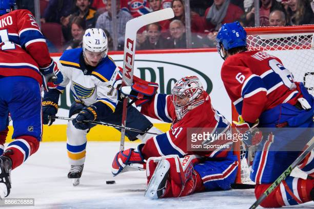 Montreal Canadiens goalie Carey Price makes a save on St Louis Blues left wing Vladimir Sobotka during the third period of the NHL game between the...