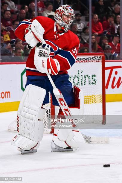 Montreal Canadiens goalie Carey Price passes the puck during the Chicago Blackhawks versus the Montreal Canadiens game on March 16 at Bell Centre in...