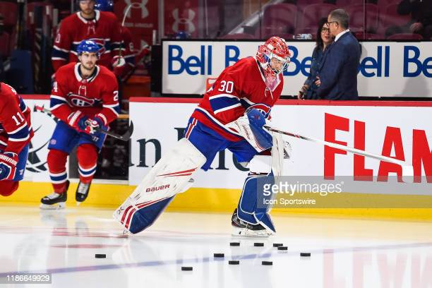 Montreal Canadiens goalie Cayden Primeau jumps on the ice first as the starting goalie for his first NHL game at warmup before the Colorado Avalanche...