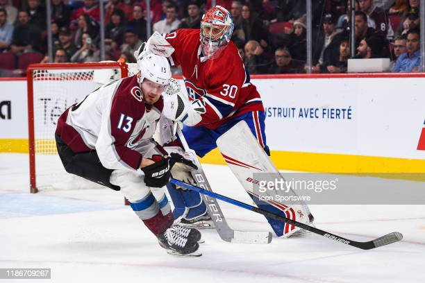 Montreal Canadiens goalie Cayden Primeau tracks his pass while Colorado Avalanche right wing Valeri Nichushkin skates in front of him during the...