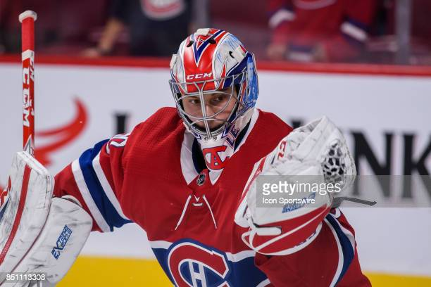Montreal Canadiens goalie Zach Fucale makes a glove save during the warmup of the NHL preseason game between the New Jersey Devils and the Montreal...