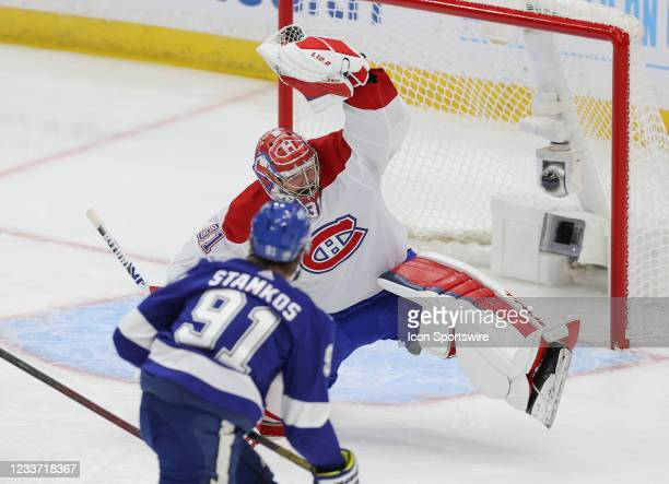 Montreal Canadiens goaltender Carey Price makes a glove save on a shot from Tampa Bay Lightning center Steven Stamkos during Game 1 of the 2021 NHL...