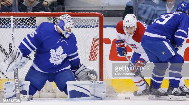 Montreal Canadiens left wing Artturi Lehkonen looks for a back way in as Toronto Maple Leafs goaltender Curtis McElhinney keeps the post covered...