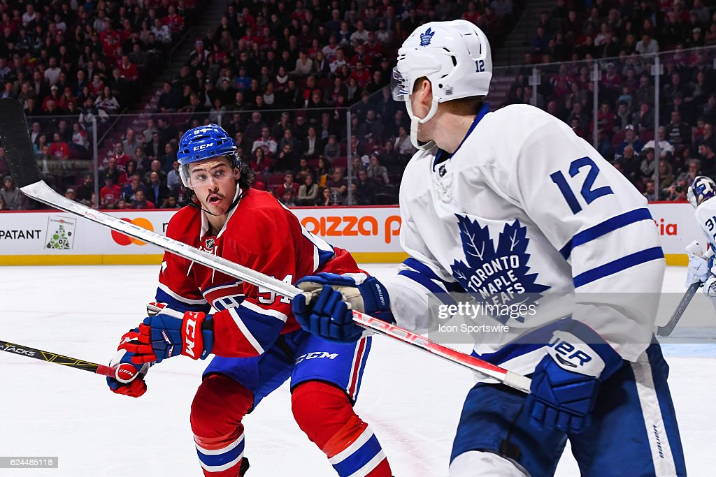 Montreal Canadiens Left Wing Charles Hudon (54) seconds before hitting Toronto Maple Leafs Right Wing Connor Brown (12) during the Toronto Maple Leafs versus the Montreal Canadiens game on November 19, 2016, at Bell Centre in Montreal, QC