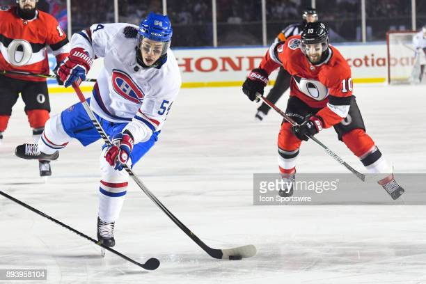 Montreal Canadiens Left Wing Charles Hudon shoots the puck during the Montreal Canadiens versus the Ottawa Senators NHL100 Classic game on December...
