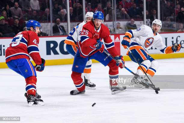 Montreal Canadiens left wing Daniel Carr looses control of the puck in front of teammate left wing Jacob de la Rose during the third period of the...