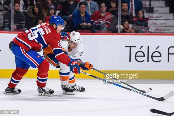 Montreal Canadiens left wing Jacob de la Rose and New York Islanders left wing Michael Dal Colle battle for the puck during the first period of the...