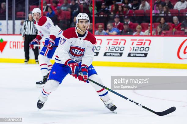 Montreal Canadiens left wing Kenny Agostino applies pressure on the forecheck during first period National Hockey League preseason action between the...