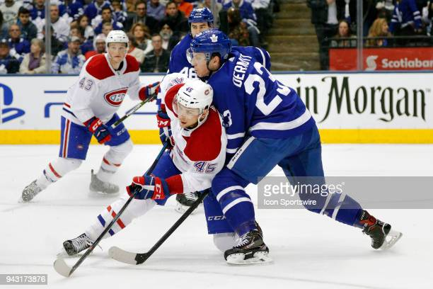Montreal Canadiens Left Wing Kerby Rychel is checked by Toronto Maple Leafs Defenceman Travis Dermott during the final NHL 2018 regularseason game...