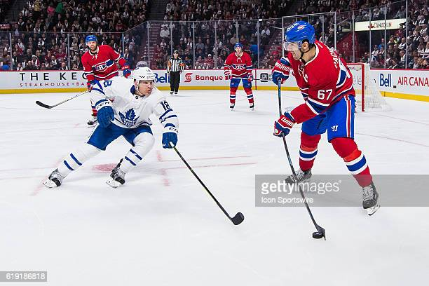 Montreal Canadiens Left Wing Max Pacioretty trying to get the puck away from his zone in front of Toronto Maple Leafs Center Ben Smith during the...