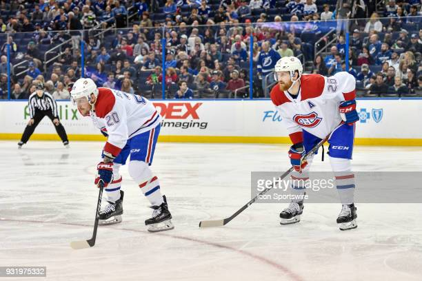 Montreal Canadiens left wing Nicolas Deslauriers and Montreal Canadiens defender Jeff Petry wait for the puck to drop during the second period of an...