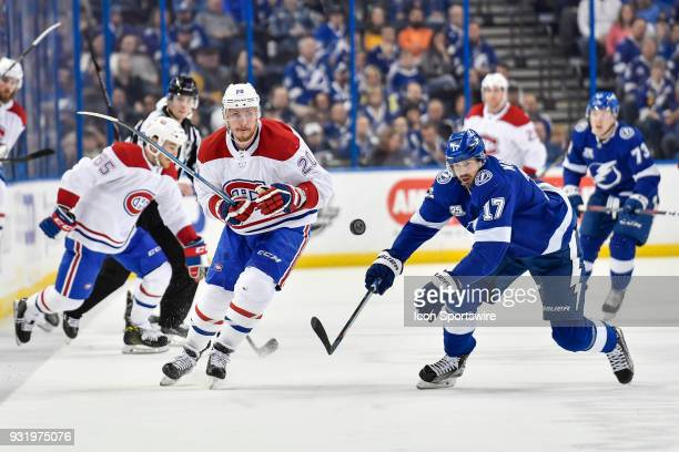 Montreal Canadiens left wing Nicolas Deslauriers flips the puck beyond the reach of Tampa Bay Lightning left wing Alex Killorn during the first...